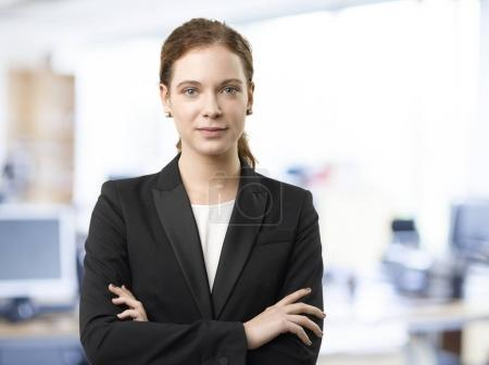 Photo for Shot of a young financial assistant businesswoman standing with arms crossed in the office. - Royalty Free Image