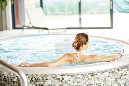 woman enjoying  jacuzzi.