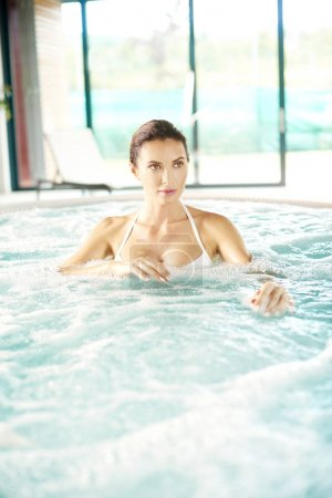 woman relaxing in the jacuzzi.