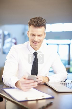 businessman using smartphone at office