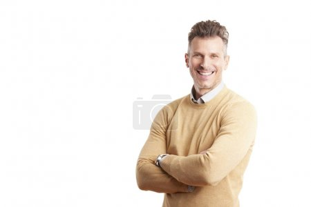 Photo for Portrait of a casual businessman standing with arms crossed at isolated white background with copy space. - Royalty Free Image