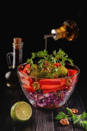 Glass bowl of salad from sliced violet cabbage wit...