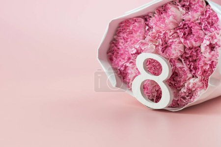Pink Carnation flower and 8th March Calendar on pi...