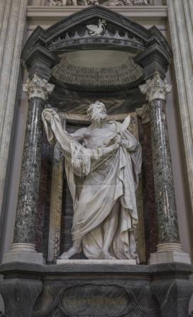 Statue of Saint Bartholomew, the martyred apostle holding his fl