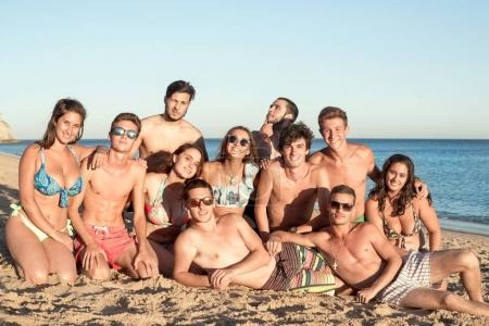 Photo for Group of happy teenage friends at the beach - Royalty Free Image