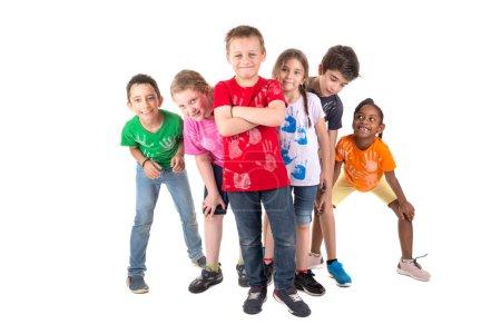Photo pour Groupe d'enfants posant isolés en blanc - image libre de droit