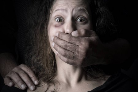 Photo for Scared woman with man's hand covering her mouth, victim of domestic violence - Royalty Free Image