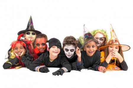 Photo for Kids with face-paint and Halloween costumes isolated in white - Royalty Free Image