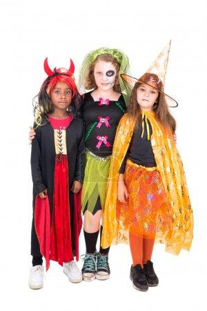 Photo pour Filles avec peinture sur le visage et costumes d'Halloween sur un fond blanc - image libre de droit