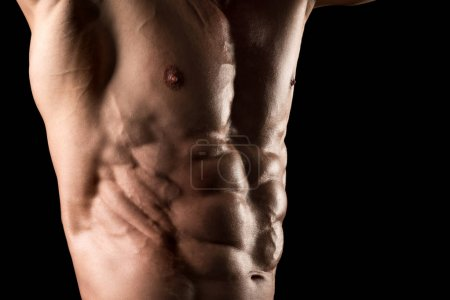 Photo for Muscled man's body part with great ripped abs - Royalty Free Image