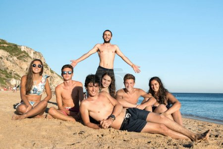 Photo for Group of happy teenage friends having fun at the beach - Royalty Free Image