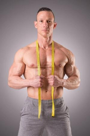 Fitness instructor with ruler