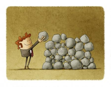 Businessman puts a stone on top of others, metaphor of effort and success in business.