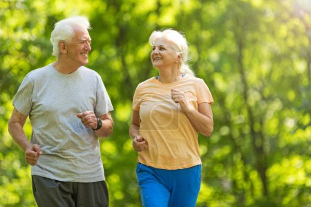 Photo for Senior couple running in park - Royalty Free Image