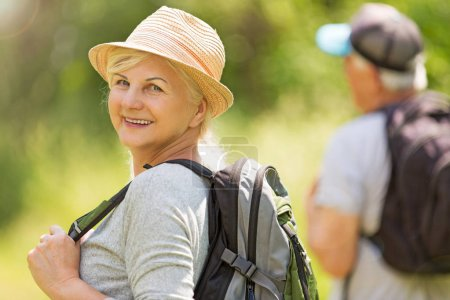 Photo for Senior couple hiking with backpacks - Royalty Free Image