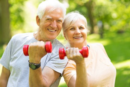 Photo for Senior Couple Exercising In Park - Royalty Free Image
