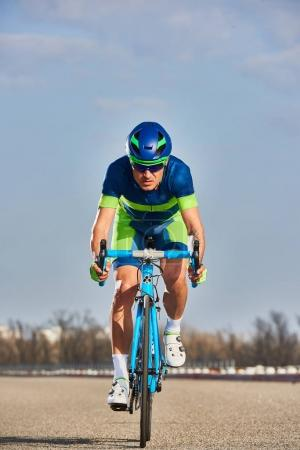 Professional Cyclist on training with his new modern bicycle 2017