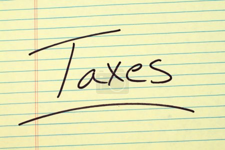 Taxes On A Yellow Legal Pad
