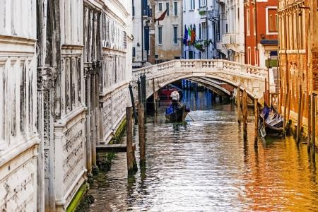 gondolier on the canal in Venice