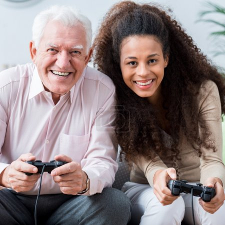Photo for Photo of modern senior playing on video game console - Royalty Free Image