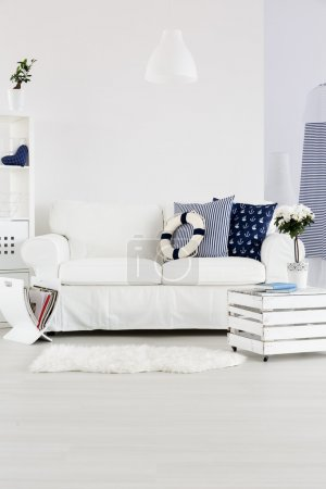 Photo for White cosy sofa in white marine style interior - Royalty Free Image
