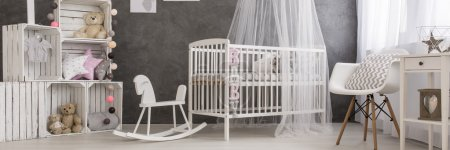 Pastel baby room decorated by loving parents
