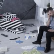 Room after burglary and despair man calling police...