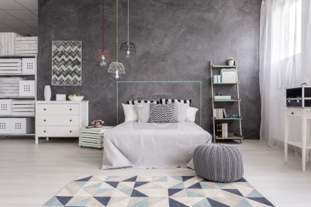 Bedroom interior with a modern rug
