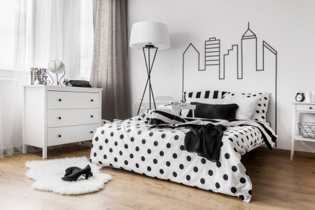 Photo for Creative female bedroom with decorative headboard wall graphic - Royalty Free Image