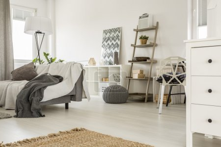 Photo for Spacious home interior in white with sofa and wooden furniture - Royalty Free Image