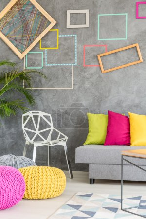 Living room with colorful frames