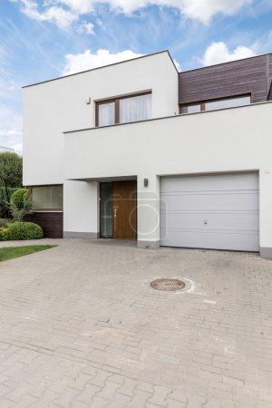 White villa with garage
