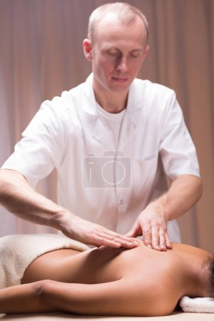 Photo for Male masseur massaging woman at spa studio - Royalty Free Image