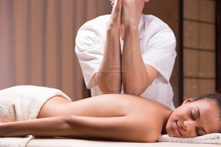 Photo for Male professional masseur doing deep tissue massage - Royalty Free Image