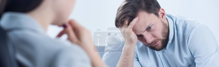 Photo for Young broken down man healing depression at psychotherapist's - Royalty Free Image