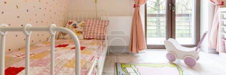 Cosy girl's bedroom with balcony