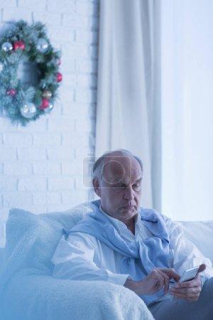 Lonely senior man on sofa