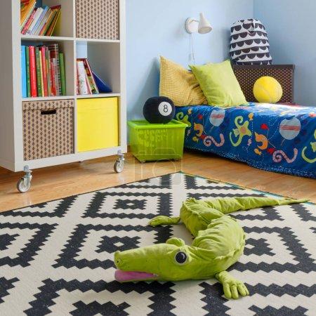 Crocodile toy on the floor