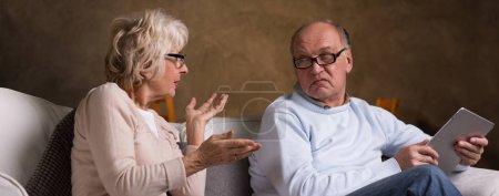 Upset elderly woman explaining