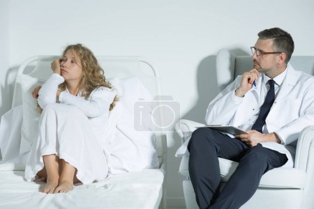 Photo for Mental hospital patient talking with a psychiatrist - Royalty Free Image