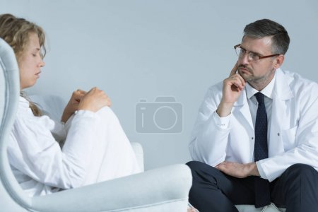 Photo for Anxious woman during meeting with a psychiatrist - Royalty Free Image