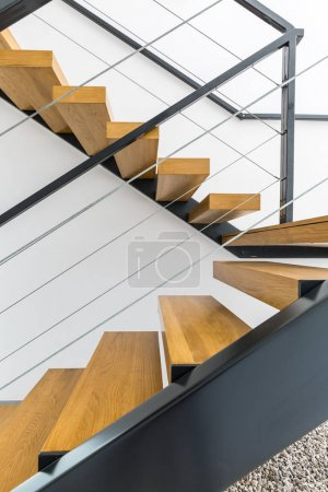 Photo for Minimalist staircase with wooden steps and white wall - Royalty Free Image