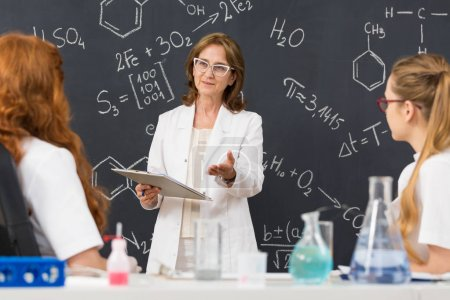Professor giving a lecture to her students