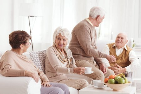Photo for Group of seniors talking and drinking coffee - Royalty Free Image