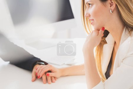 Businesswoman seductively holding colleague's hand