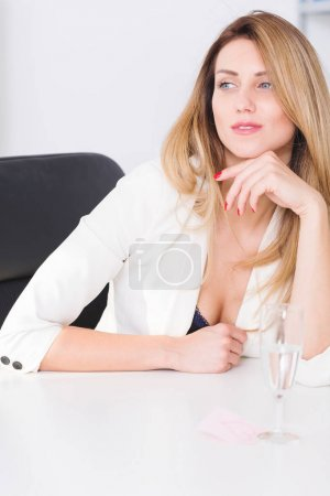 Beautiful businesswoman sitting in office