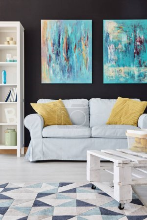 Photo for Modern living room decor with paintings on the black wall - Royalty Free Image