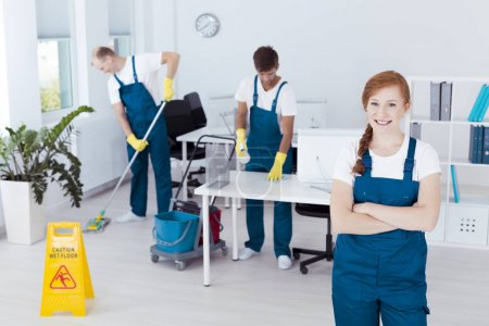 Cleaners working in office