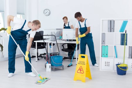 Cleaners cleaning an office