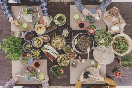 Photo for Top view of people eating vegetarian dinner - Royalty Free Image